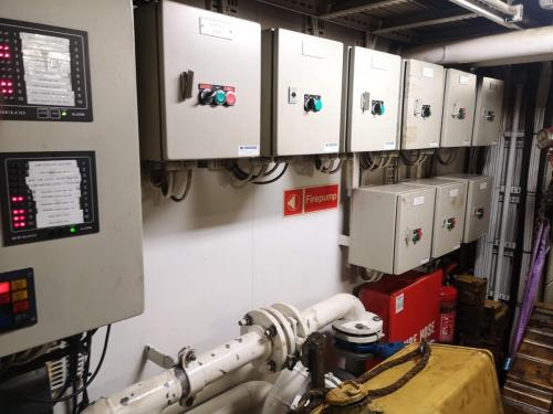 Electrical equipment and pipework before removal to allow the bulkhead to be removed